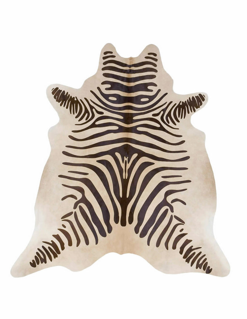 Zebra print cowhide rug brown on light beige