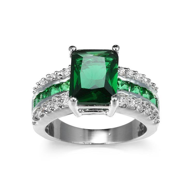 Emerald Galore Engagement Ring