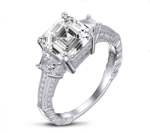 Three stones square cut diamond engagement ring