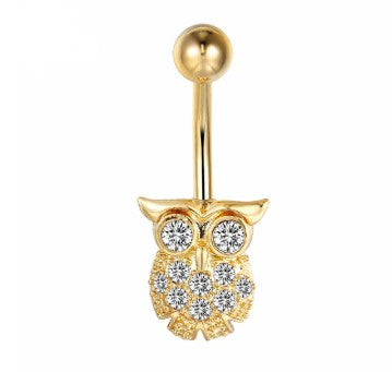 piercing hibou or ventre corps nombril