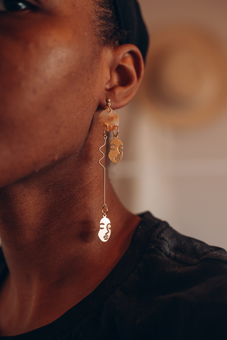 Long Face Abstract Art Dangle Earring in gold and translucent white