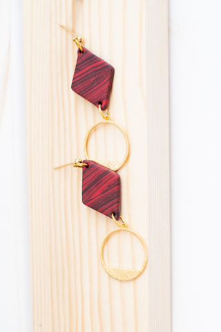 red and black diamond shaped marble earring with gold colored hypoallergenic brass circular loop