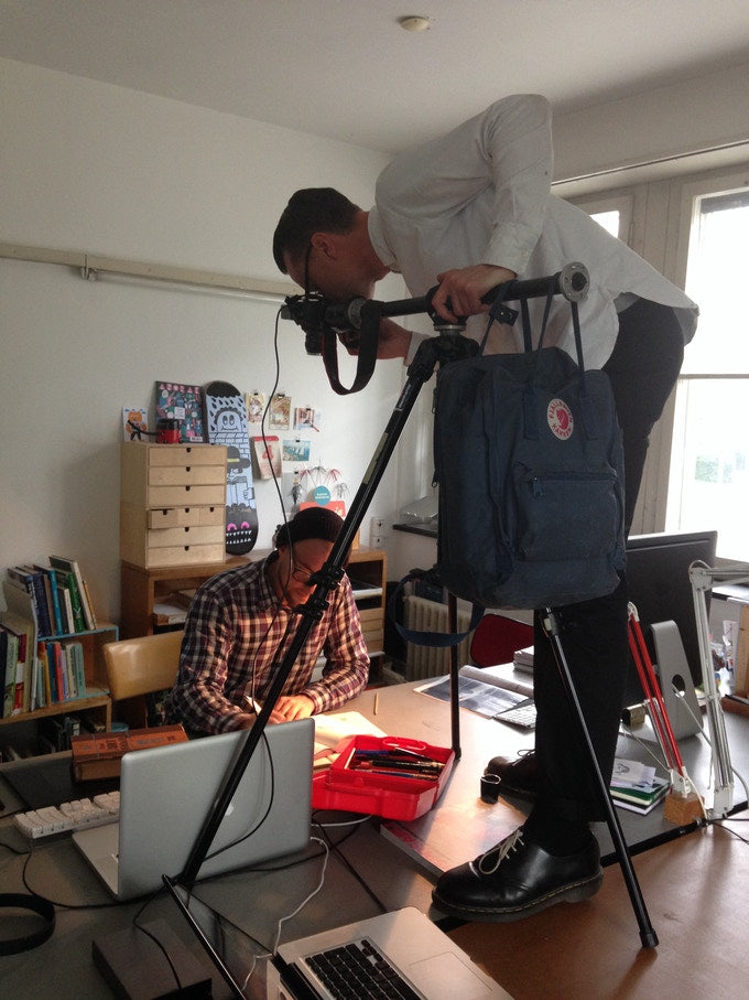 Jake photographing illustrator Jurg Lindenburger in Basel  for 'The Bookmakers' Studio', 2014.