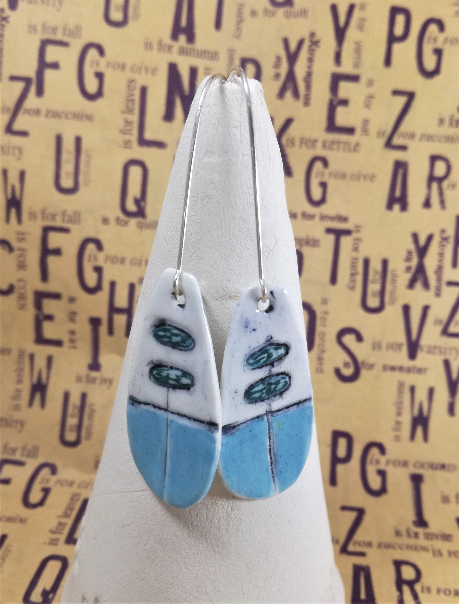 White with turquoise half dangle