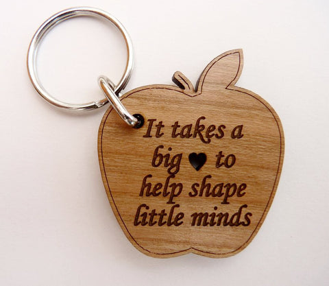 """It takes a big heart to shape little minds"" Apple Keyring 