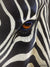 A wildlife print of a Zebra up close showing the Zebra's eye by artist David Bucklow entitled Eye of the Beholder