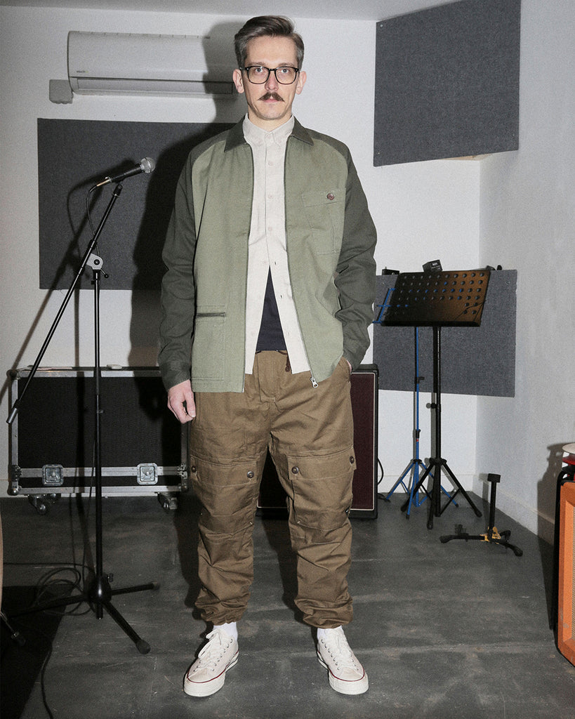 mike brickwork studios wearing ghost patrol workwear jacket and waxed cotton pants
