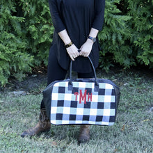 Load image into Gallery viewer, Lifestyle view of our Buffalo Check Duffle Bag