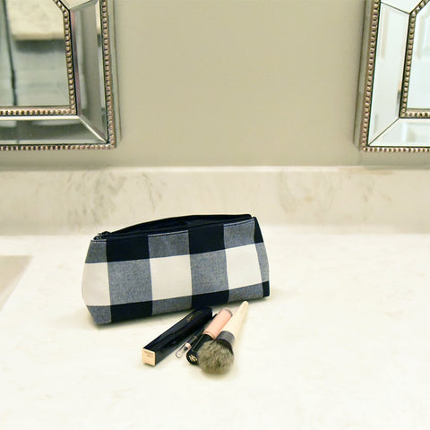 Lifestyle view of our Buffalo Check Grab and Go Pouch