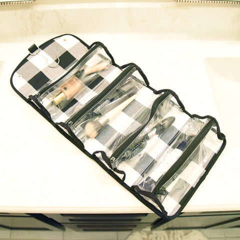 Lifestyle view of our Buffalo Check Roll Up Cosmetic Bag