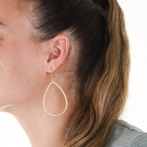 Lifetsyle view of our Ivory Bead Teardrop Earring