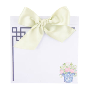 Top view of our Lime Green Flower Southern Blooms Bow Notepad