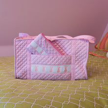 Lifestyle image of our Smocked Accessory Pouch