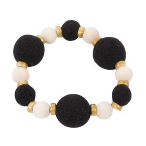 Front view of our Black Felt Bead Bracelet
