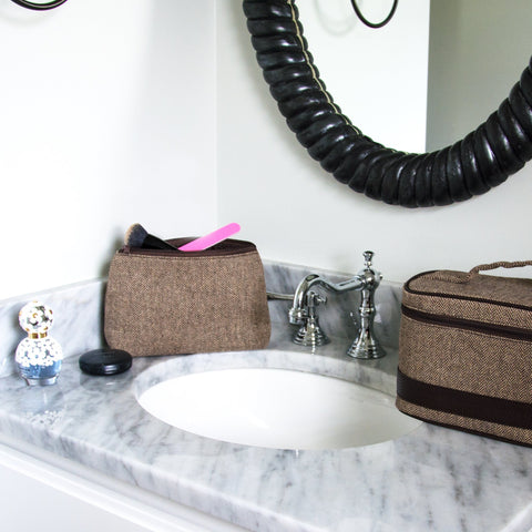 Lifestyle of our Herringbone Cosmetic Pouch with matching Train Case