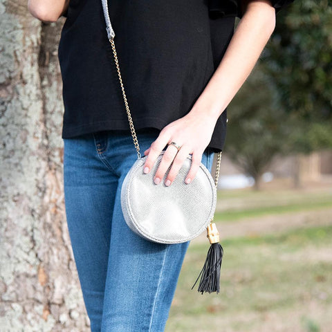 Lifestyle view of our Black Bamboo Circle Crossbody
