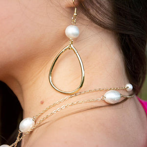 Lifestyle view of our Teardrop Hoop Textured Pearl Earring