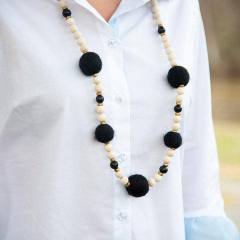 Lifestyle view of our Black Felt Bead Necklace