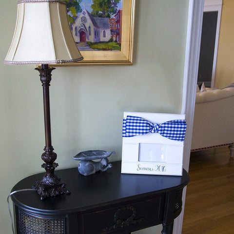 Blue Gingham bow frame on a console table at a home