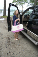Load image into Gallery viewer, Model carrying a monogrammed pink gingham duffle bag
