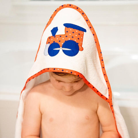 Lifestyle view of our Red Train Boy Hooded Towel