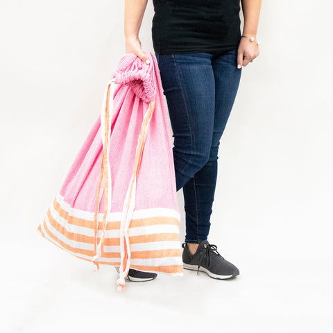 Lifestyle image of our Pink and Orange Color block Laundry Bag