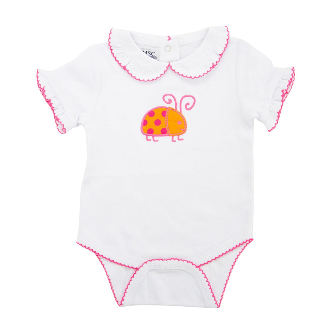 Front view of our Orange Ladybug Girl Bubble Onesie