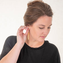 Load image into Gallery viewer, Lifestyle view of our Camel Pebble Grain Accent Earrings