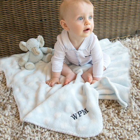 Lifestyle image of our Plush Polka Dot Blanket
