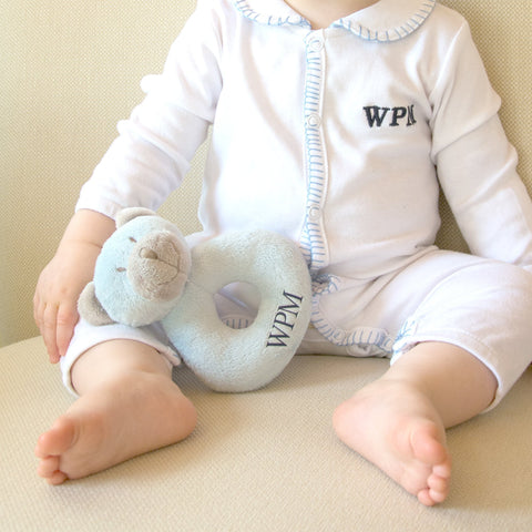 Lifestyle image of our Blue Bear Plush Rattle