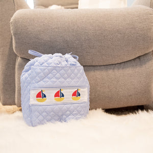 Lifestyle image of our Navy Boat Smocked Ditty Bag