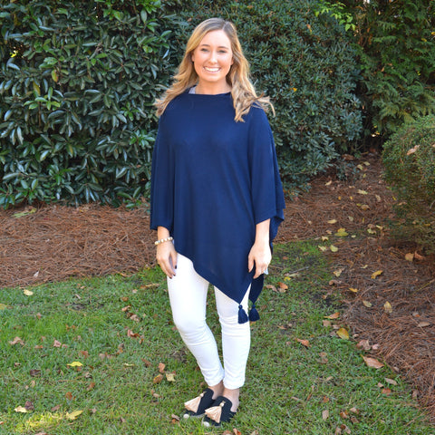 Lifestyle Image of our Navy Spring Tassel Poncho