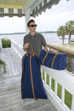 Load image into Gallery viewer, Young man carrying his suit bag and duffle bag