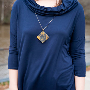Lifestyle view of our Tortoise Square Disc Necklace
