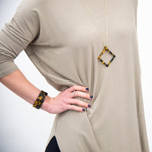 Load image into Gallery viewer, Lifestyle view of our Tortoise Square Frame Necklace