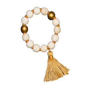 Top view of our Gold Bead Tassel Bracelet