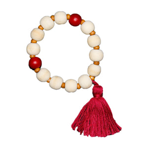 Top view of our Red Bead Tassel Bracelet