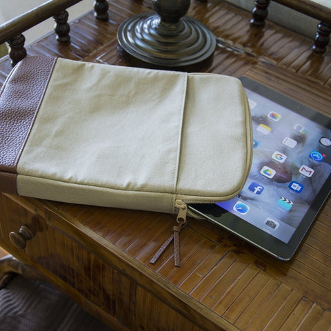 Canvas tablet case placed on a console table with a tablet sticking out