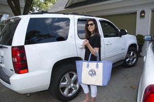 Woman heading out of the house with her blue gingham weekender tote