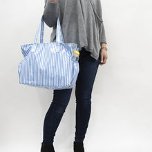 Load image into Gallery viewer, Lifestyle view of our Blue Stripe Vinyl Diaper Bag
