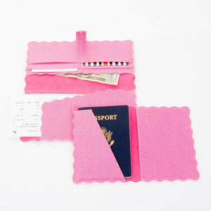 Lifestyle view of our Pink Lizard Scallop Passport Holder