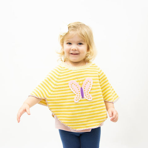 Lifestyle view of our Yellow Butterfly Toddler Poncho