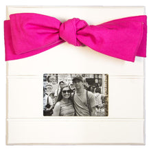 White picture frame with pink canvas bow