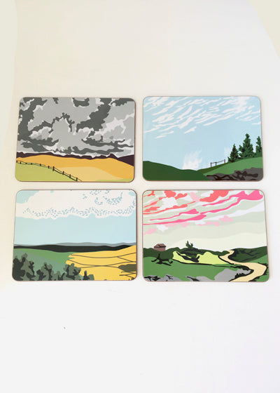 A Set of Four Rural Cloudscape Place Mats