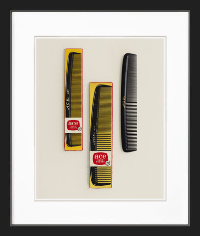 three plastic combs black frame