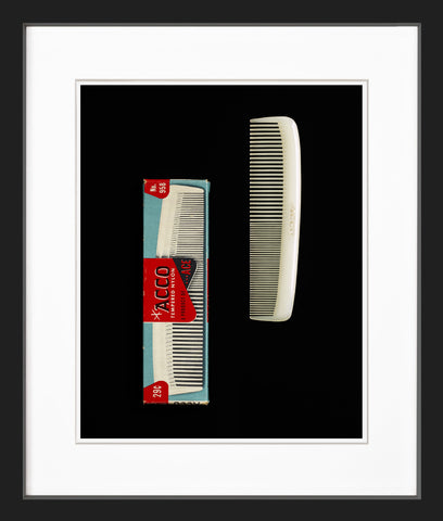 Two plastic combs black frame