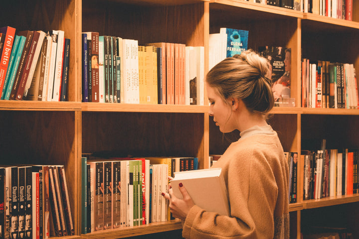 image of a woman in a library looking for Japanese language learning resources Online Japanese Learn Japanese Free Learn to speak japanese Japanese language course Online Japanese tutor