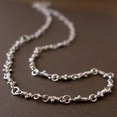 Bitsy necklace, sterling silver knot links chain.