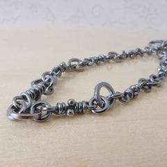 Neela silver knots bracelet, dark finish