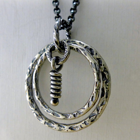 Lunar sterling silver round pendant